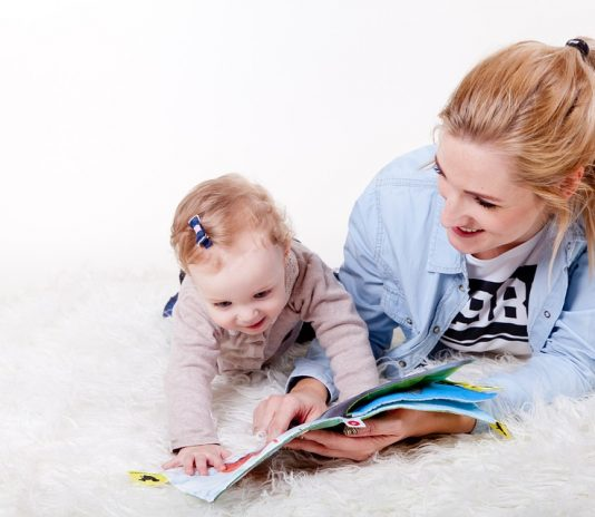 mother and its baby read a book