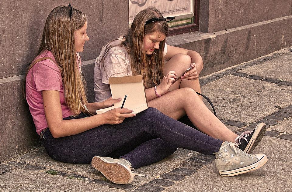 teenage girls chatting on phones