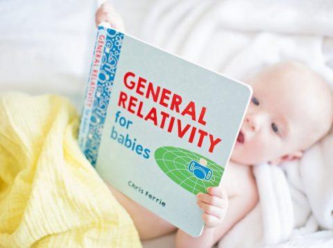a baby read a book