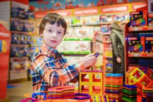 child-purchasing-toy-in-shopping-centre